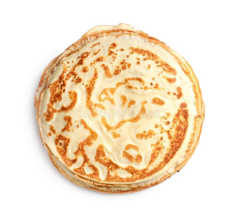 Pila di pancake sottile su fondo bianco, immagine stock