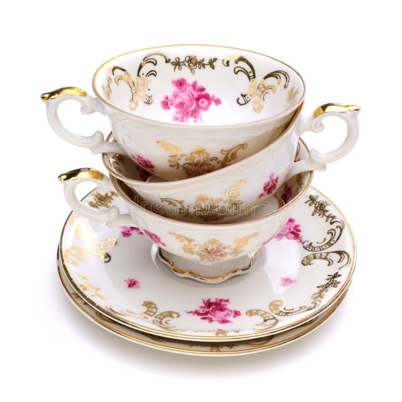 Pila di tazze di tè antiche fotografie stock