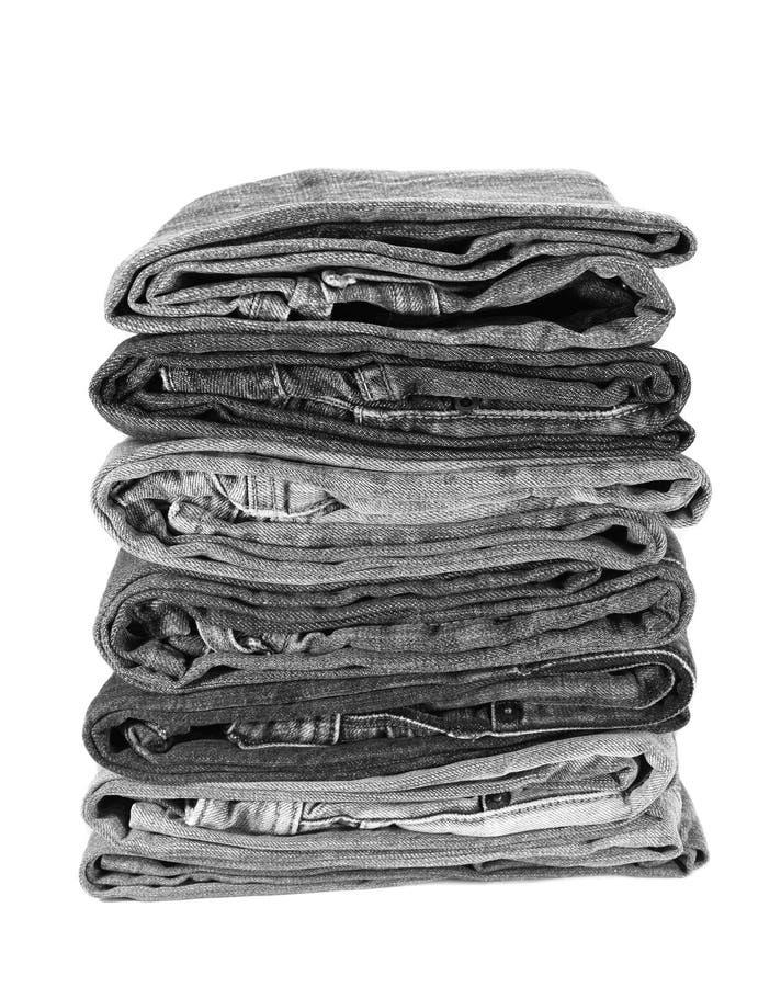 Pila di tralicco nero del denim fotografia stock libera da diritti