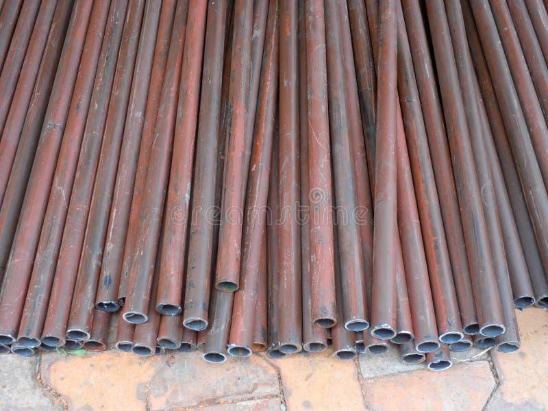 Pila di tubi d'acciaio fotografia stock