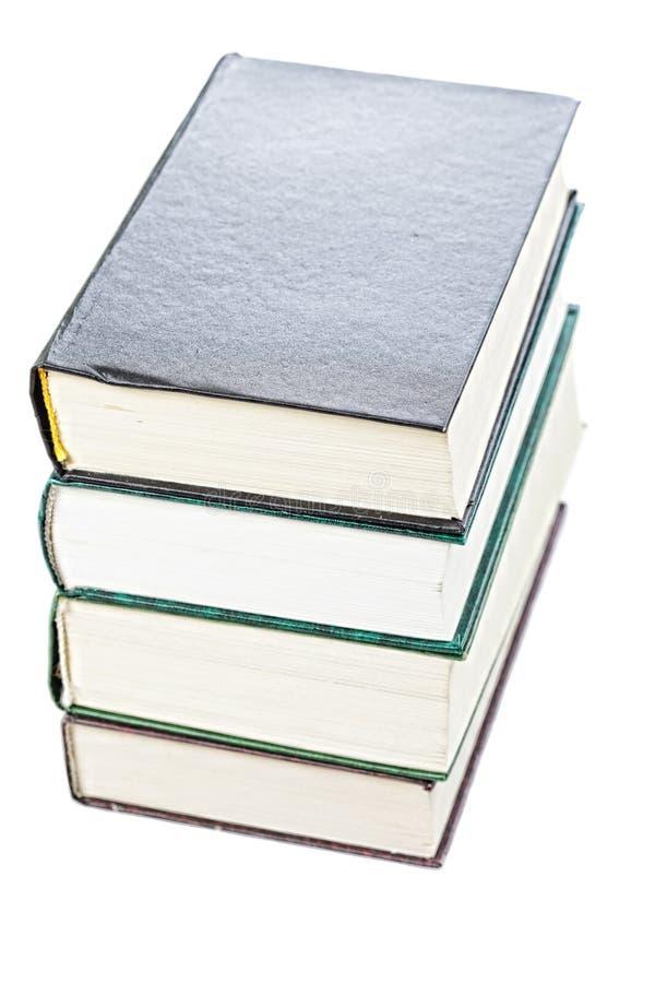 Pila di vecchi libri sopra la vista immagine stock libera da diritti