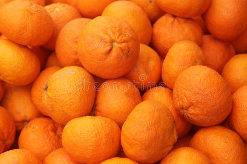 Pila grande de clementinas maduras imágenes de archivo libres de regalías