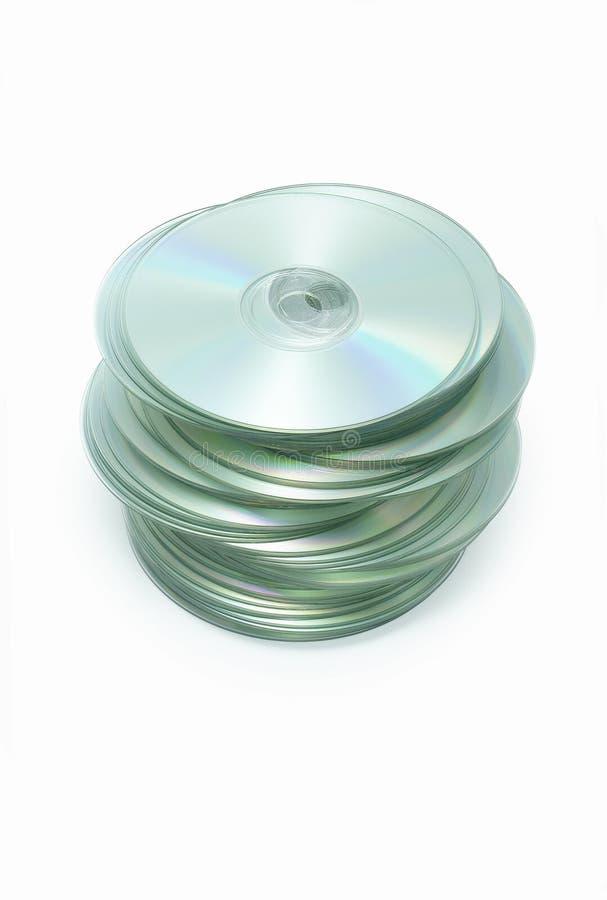 Pila sudicia di dischi CD su bianco fotografia stock libera da diritti