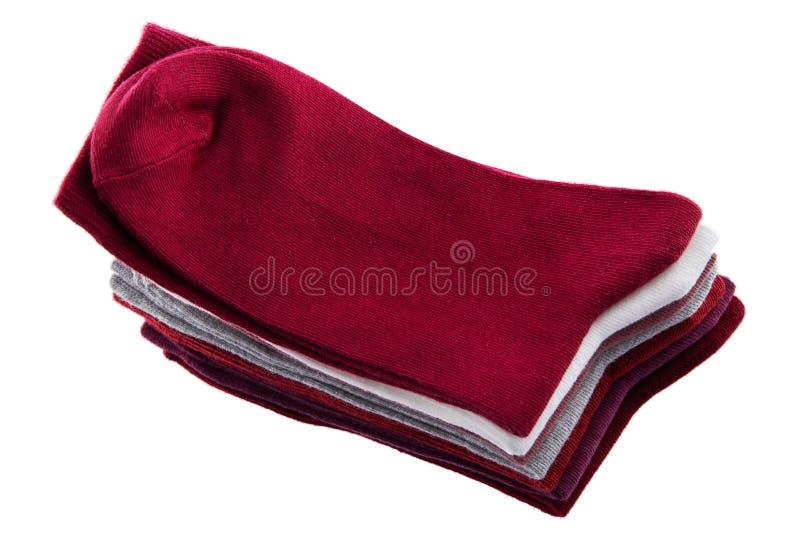 Pila variopinta di nuovi calzini isolati su fondo bianco fotografie stock