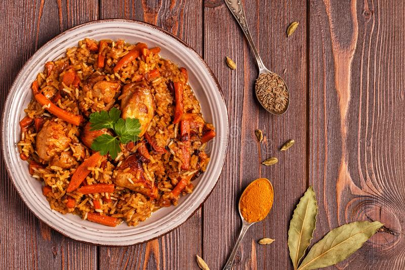Pilaf biryani on a wooden background, top view. Copy space stock photography