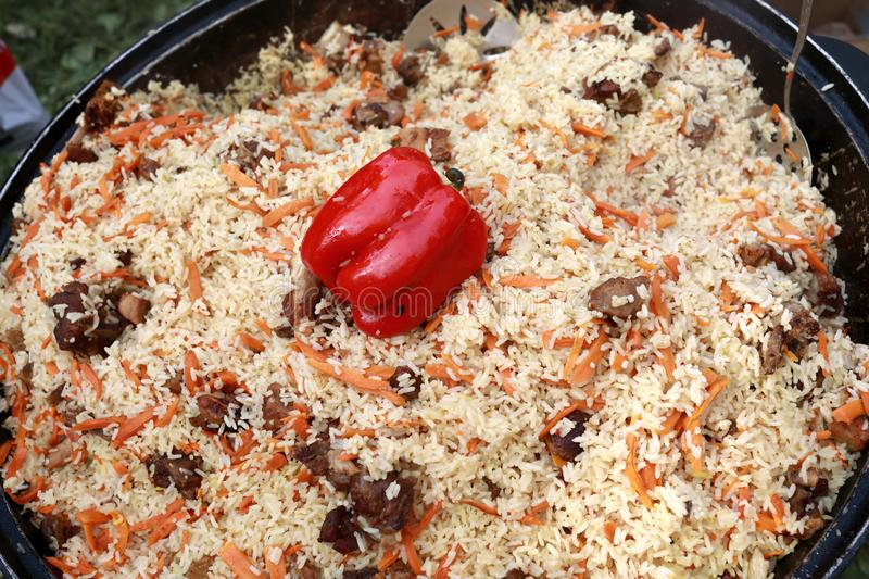 Pilaf cooked in cauldron. Pilaf cooked in a cauldron on picnic stock photography