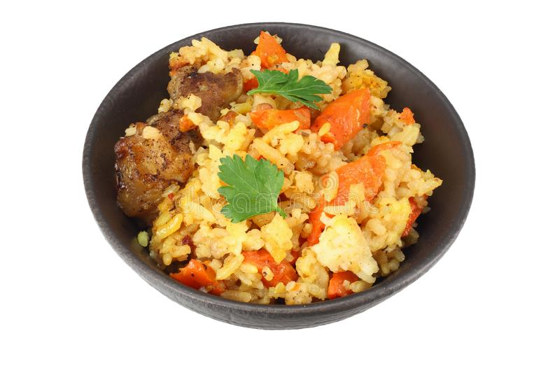 pilaf with meat in black bowl isolated on white background stock photos