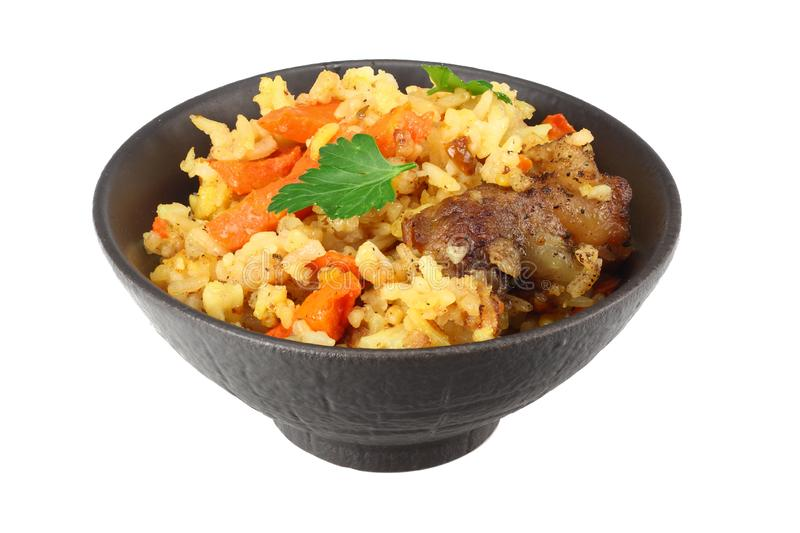 pilaf with meat in black bowl isolated on white background royalty free stock photos