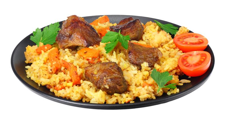 pilaf with meat on black plate isolated on white background stock photography