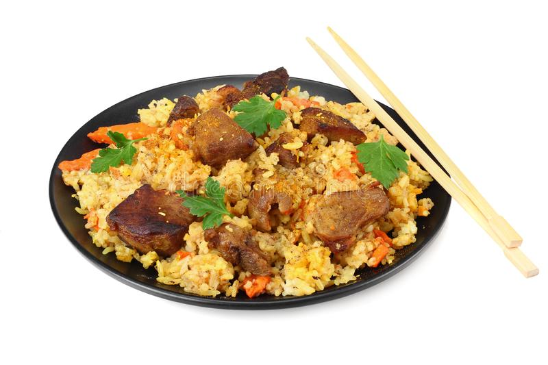 pilaf with meat on black plate isolated on white background royalty free stock photography