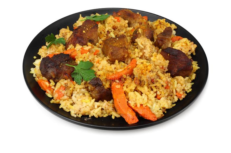 pilaf with meat on black plate isolated on white background royalty free stock images
