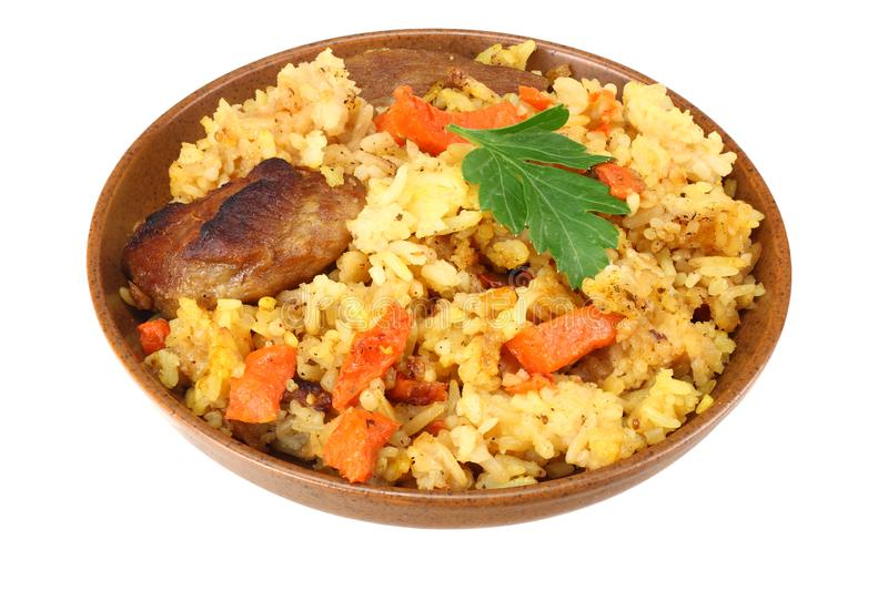 pilaf with meat on brown plate isolated on white background stock image