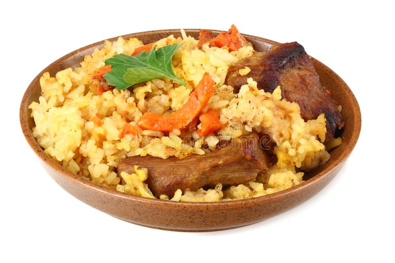 pilaf with meat on brown plate isolated on white background royalty free stock image