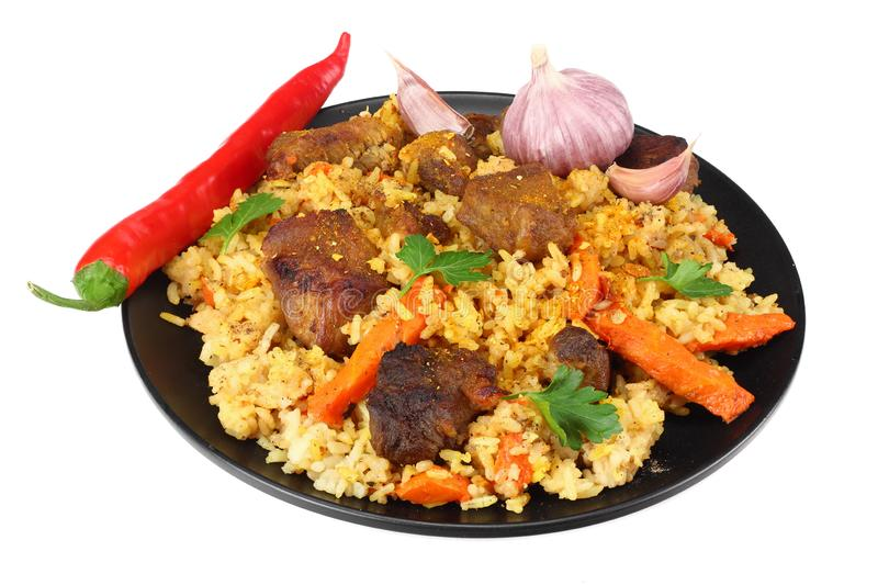 pilaf with meat and chili pepper on black plate isolated on white background royalty free stock photos