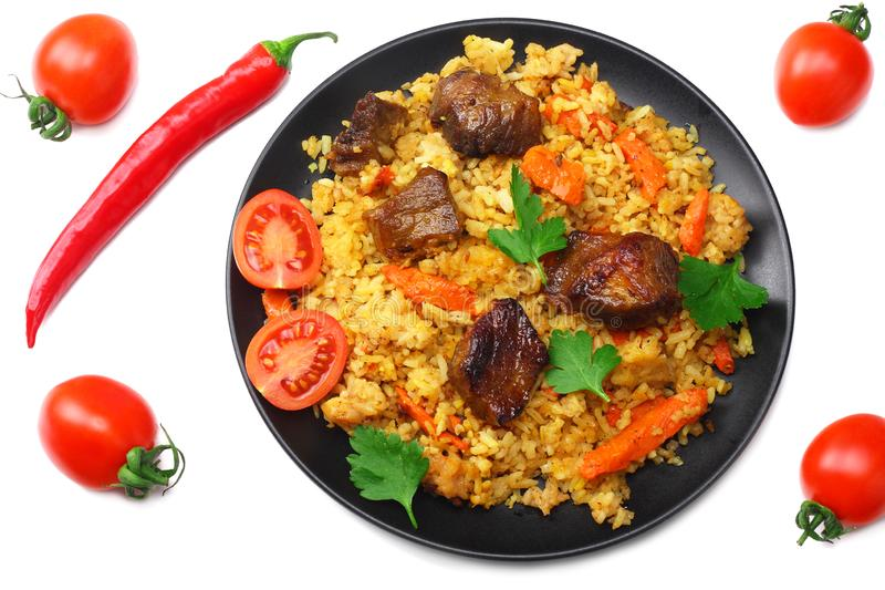 pilaf with meat and chili pepper on black plate isolated on white background. top view royalty free stock photo