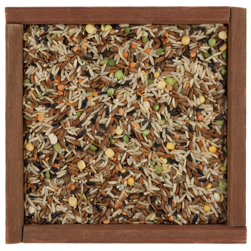 Pilaf mix in a wooden box stock images