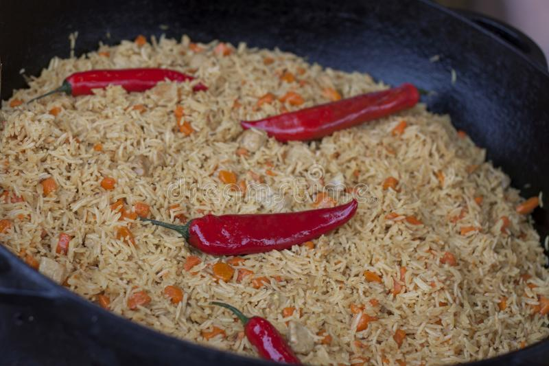 Pilaf, rice and meat with peppers stock photos