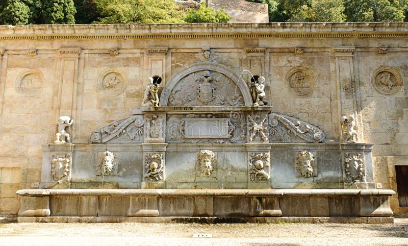 Pilar de Carlos V: fountain in Granada. Pilar de Carlos V: beautiful rinascimental fountain on the hill of the Alhambra in Granada, Spain royalty free stock image