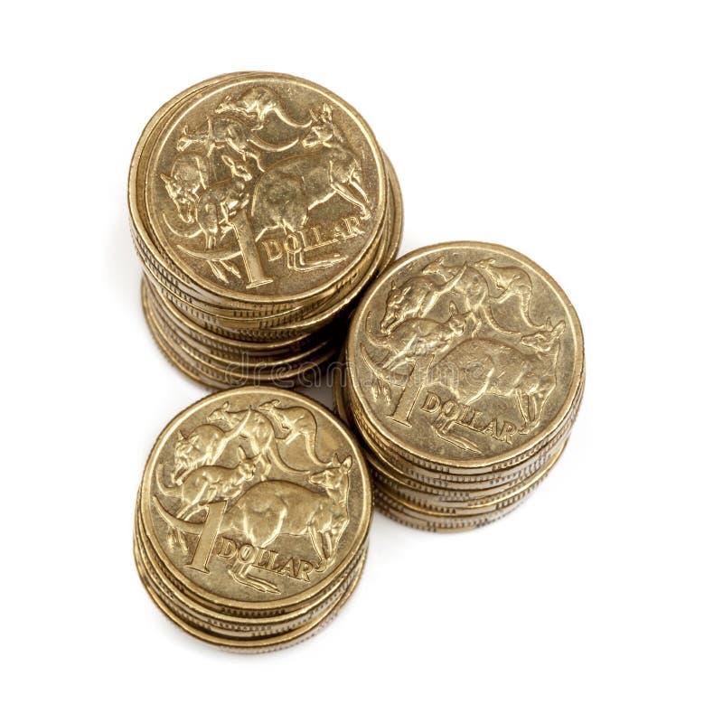Pilas de australiano monedas de un dólar foto de archivo