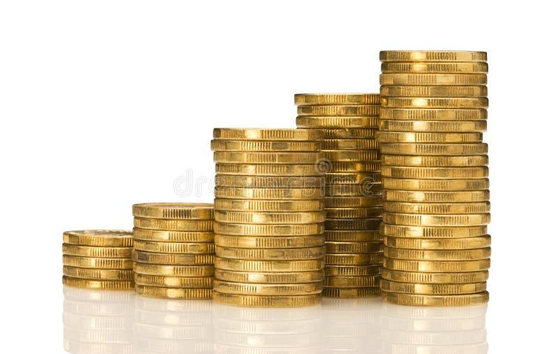 Pilas de dinero del oro imagenes de archivo