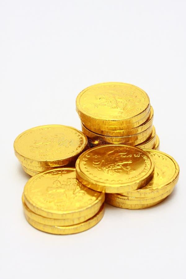 Pilas de la moneda de oro del chocolate imagen de archivo libre de regalías