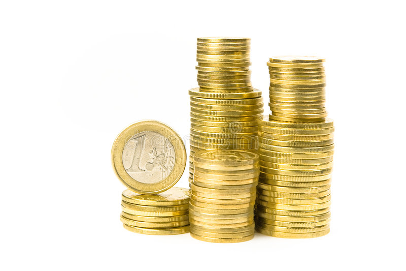 Pilas de monedas imagenes de archivo