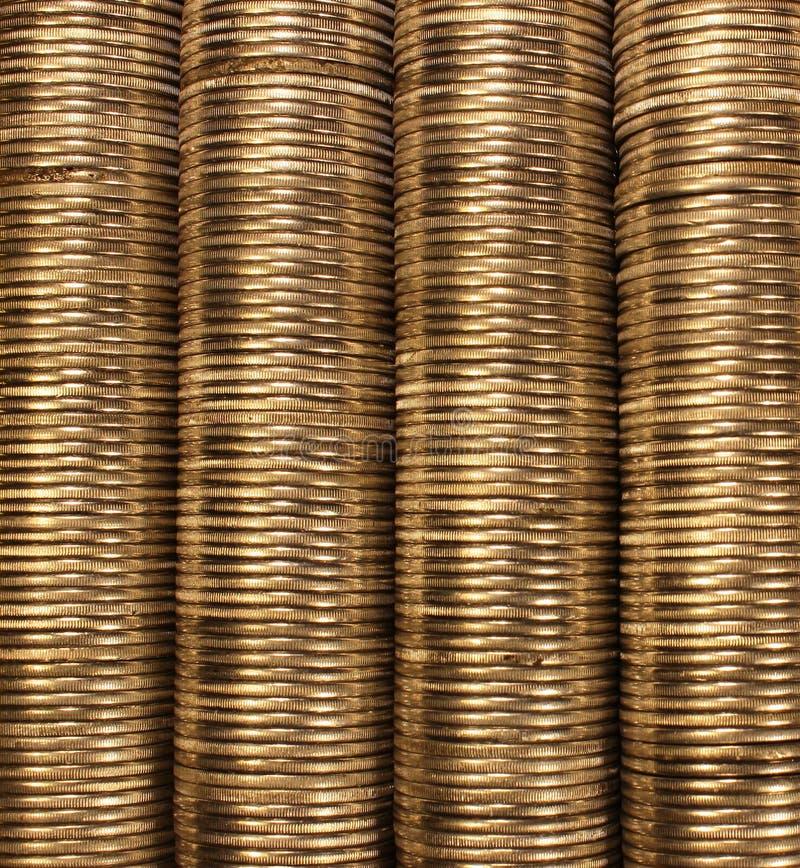 Pilas de oro de la moneda como fondo fotos de archivo libres de regalías