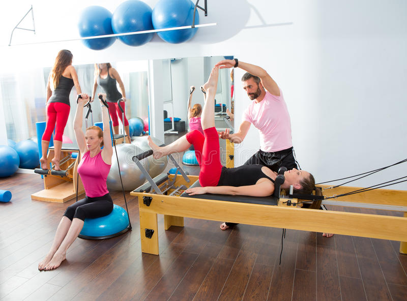 Pilates aerobic personal trainer man in cadillac royalty free stock photo