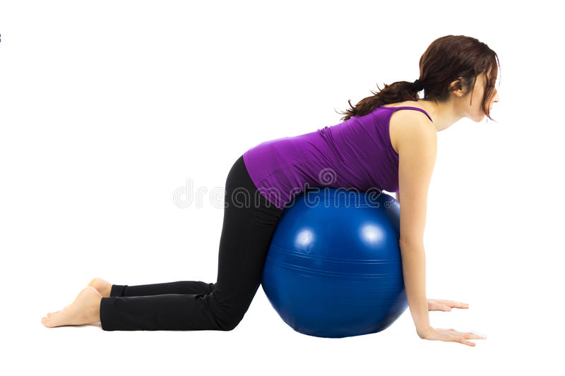 Pilates ball exercise for abs royalty free stock images