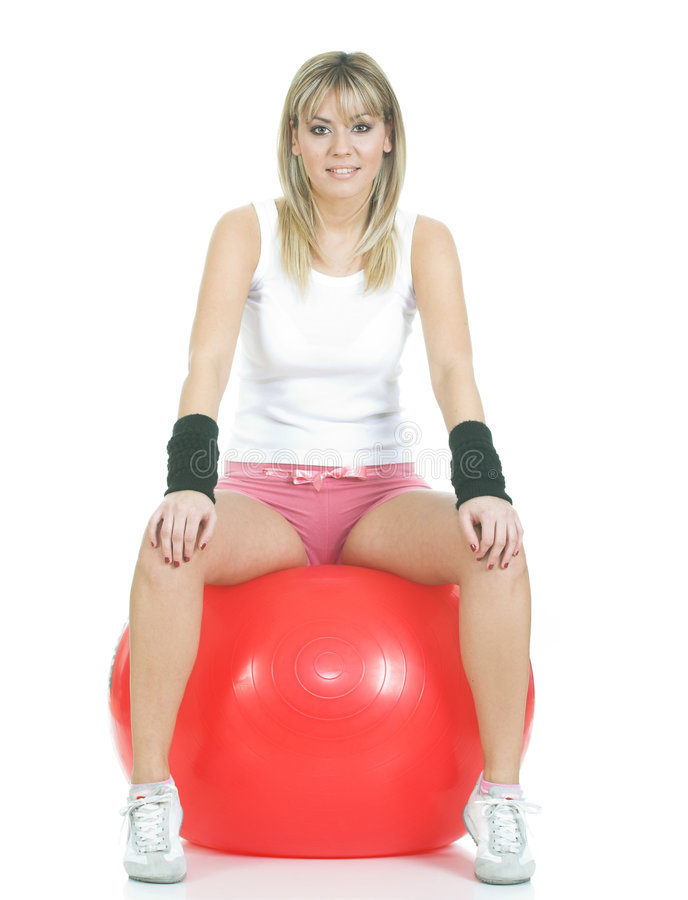 Pilates ball - fitness girl royalty free stock images
