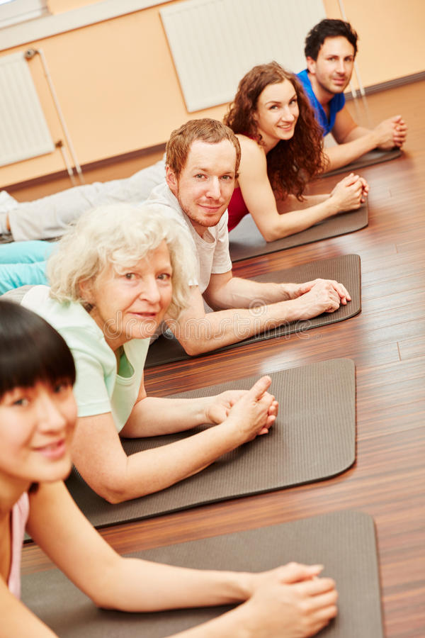 Pilates class with senior woman royalty free stock photography