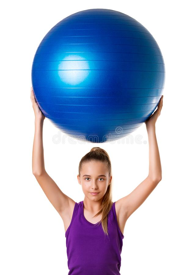 Pilates fitness young girl exercising with exercise bal royalty free stock images