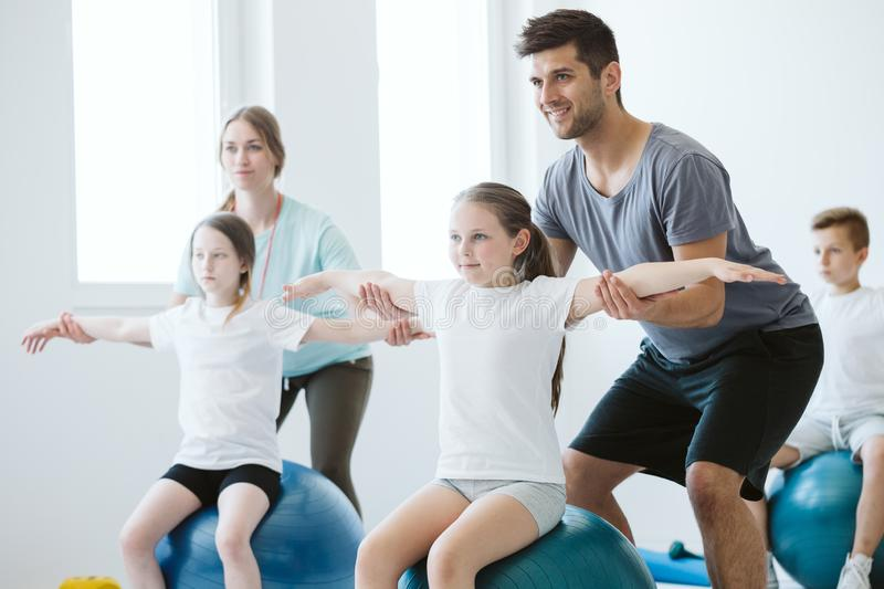 Pilates on physcial education. Kids exercising pilates on physcial education classes stock photo