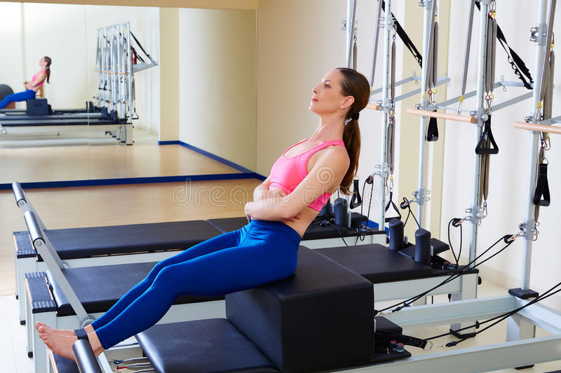 Pilates reformer woman short box flat exercise royalty free stock images