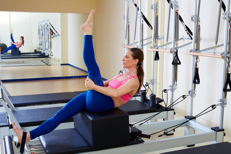 Pilates reformer woman short box tree exercise royalty free stock photos