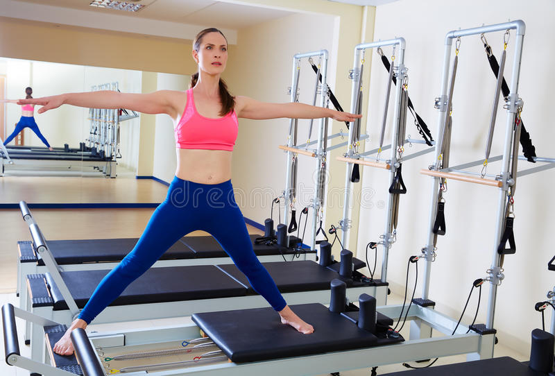 Pilates reformer woman side split exercise stock photography