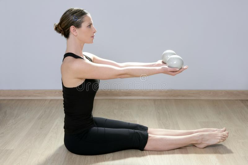 Pilates tonning ball woman yoga aerobics sport gym. Pilates toning ball woman yoga aerobics sport gym girl royalty free stock photo