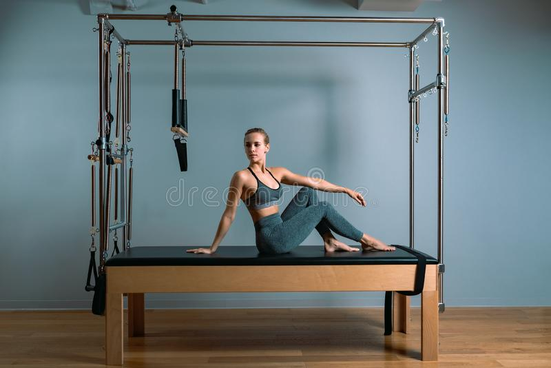 Pilates woman in a Cadillac reformer doing stretching exercises in the gym. Fitness concept, special fitness equipment. Healthy lifestyle, plastic. Copy space stock images