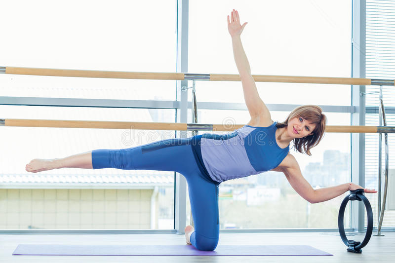 Pilates woman magic ring hands exercise workout at gym indoor royalty free stock images
