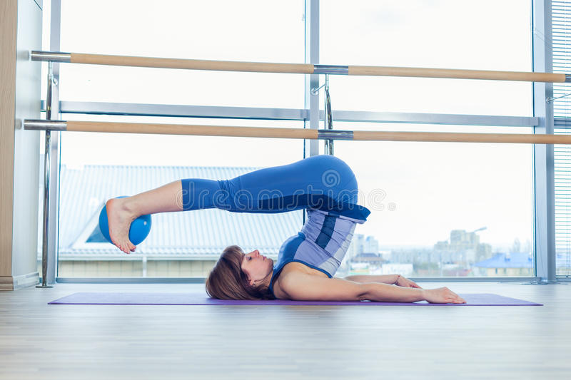 Pilates woman stability ball exercise workout at gym indoor royalty free stock photography