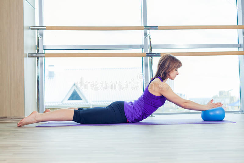 Pilates woman stability ball gym fitness yoga exercises girl. royalty free stock photography