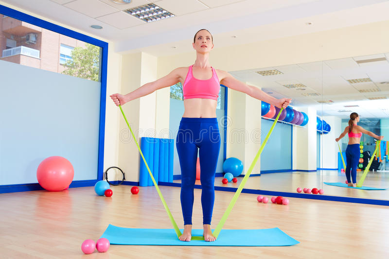Pilates woman standing rubber band exercise royalty free stock images