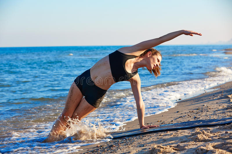 Pilates yoga workout exercise outdoor on beach stock image