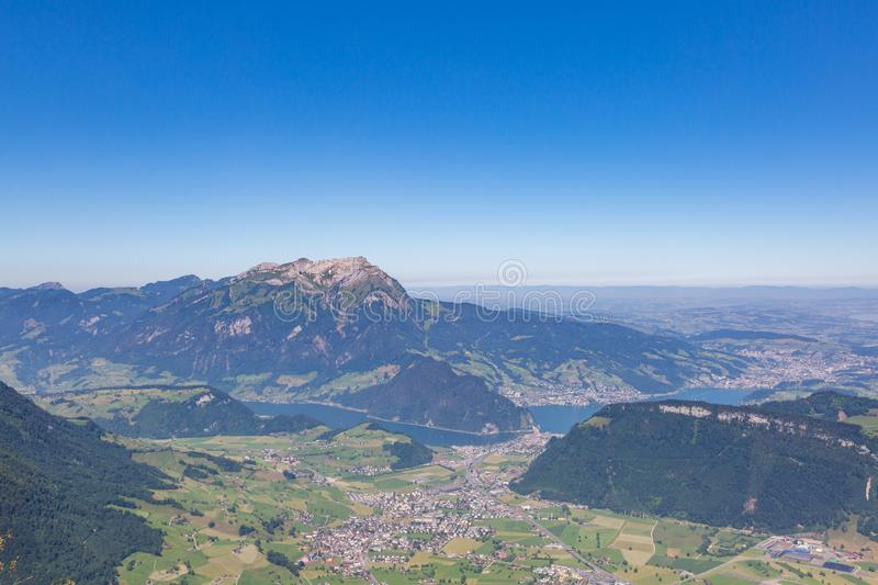 Pilatus mountain, village of Stans, lake Lucerne with blue sky. In summer stock images