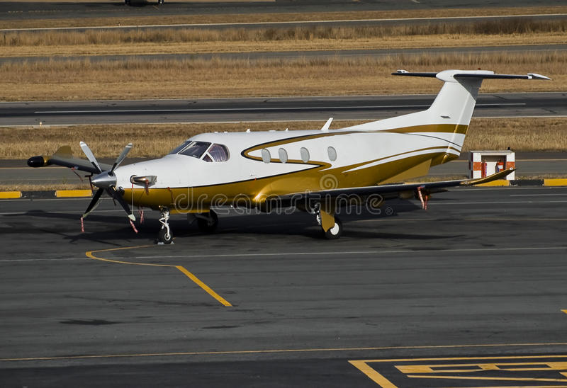 Pilatus PC-12/45. Parked on the the apron. New angle, closer cropping on the plane stock images