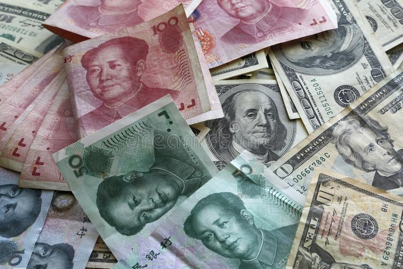 A pile of America and China currency stock photos