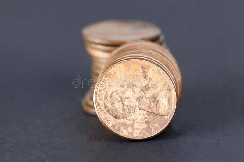 A pile of American cents. Of poor condition and quality lying on a black paper surface royalty free stock images