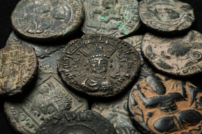 Pile of ancient islamic bronze coins close-up shot stock photo