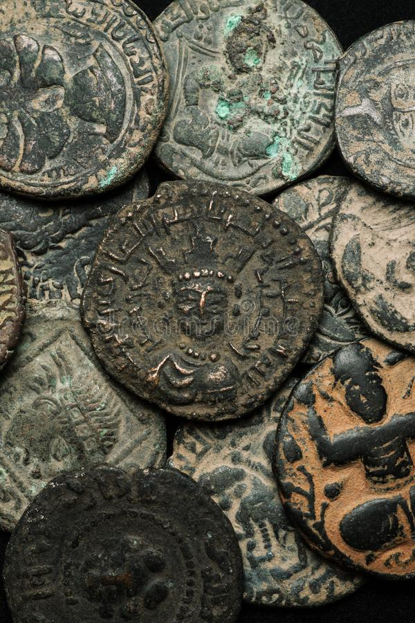 Pile of ancient islamic bronze coins close-up shot stock images