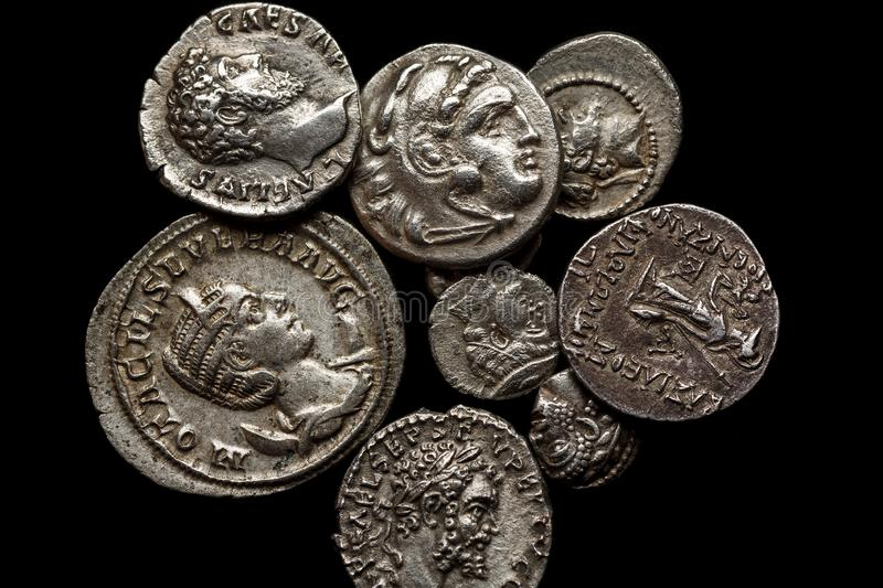 Pile of ancient silver coins on black background, top view.  royalty free stock photography